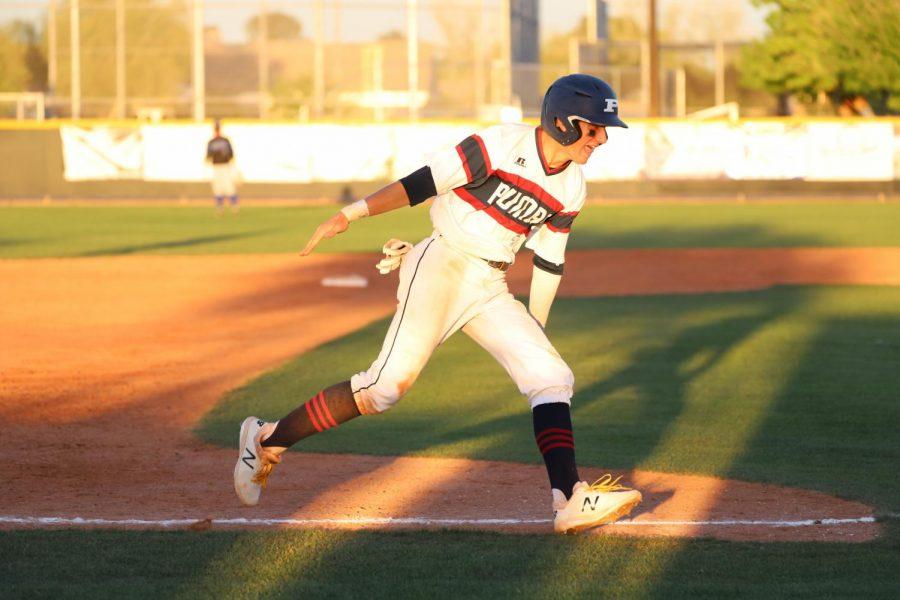 photo by Debbie Moon:  Trenton Pallas celebrating home run, in last years game against Chandler.