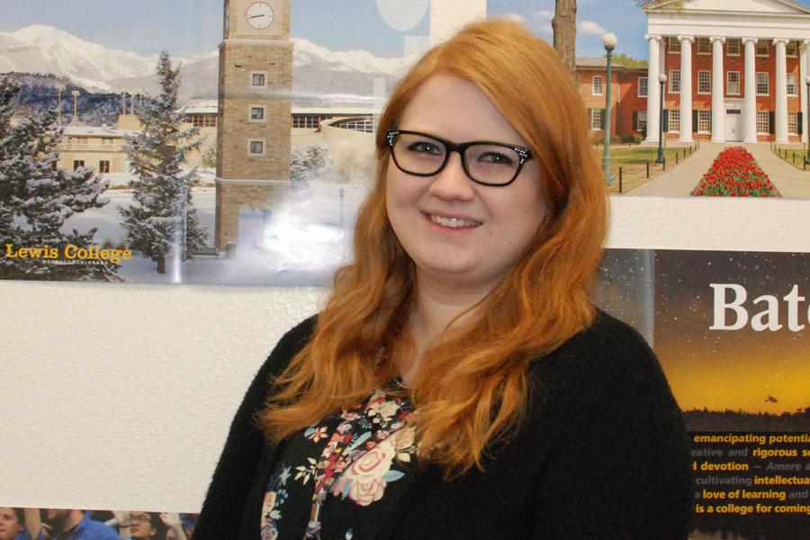 New employee, Jocelyn Whiteneck, poses in the Career Center