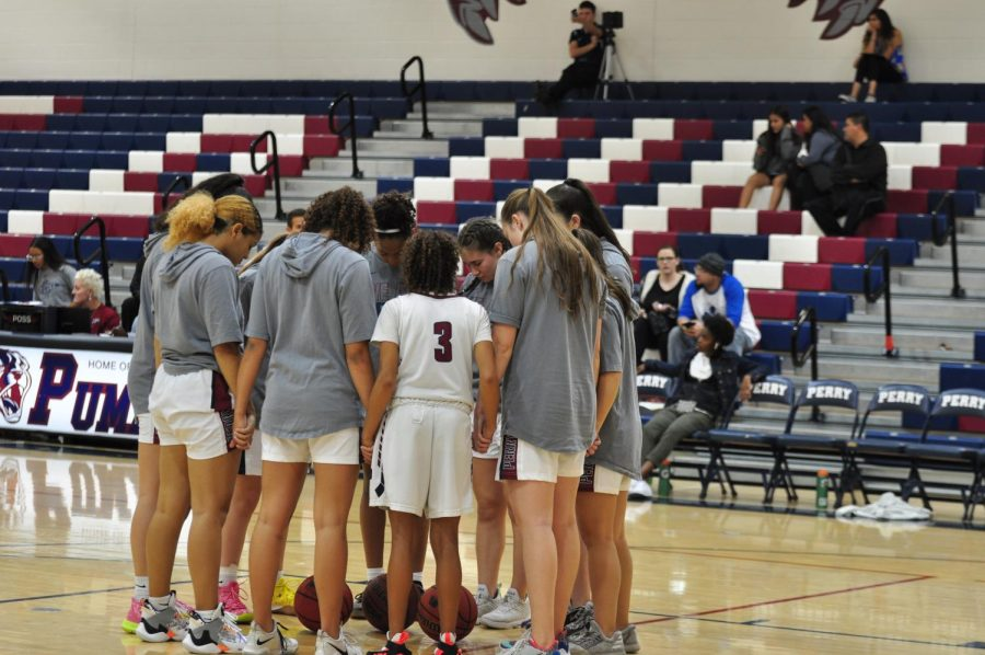 The team shares a moment before a game.