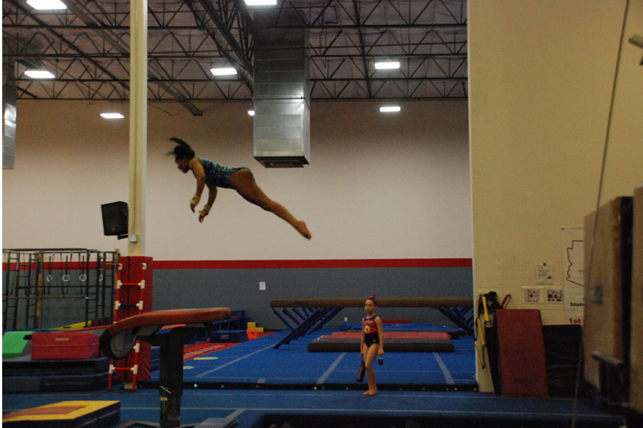 Level+10+gymnast+Joi+Morrison+flying+high+on+a+vault+at+practice.+