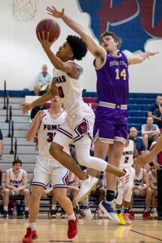 Junior Christian Tuckers goes up for a layup against Queen Creek.