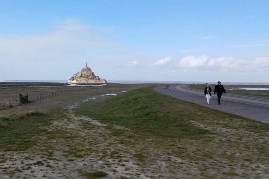 Mont Saint Michel has only a few people walking up to it. No tourists were risking catching the virus.
