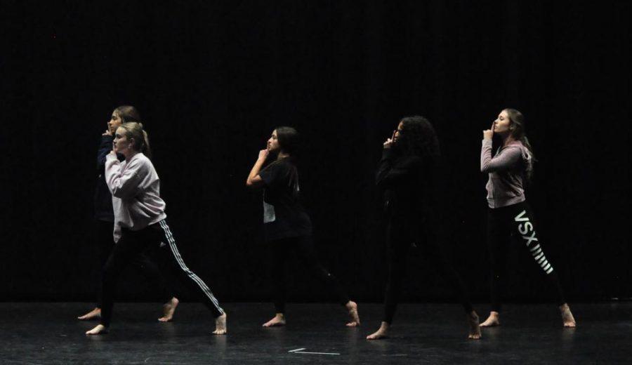 Moveo dancers practice in the school auditorium.