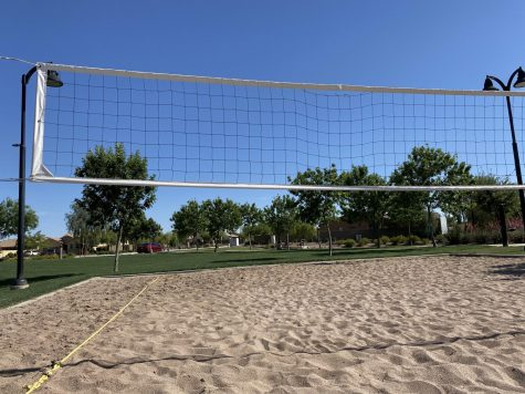 beach volleyball courts are empty but the team still has high hopes