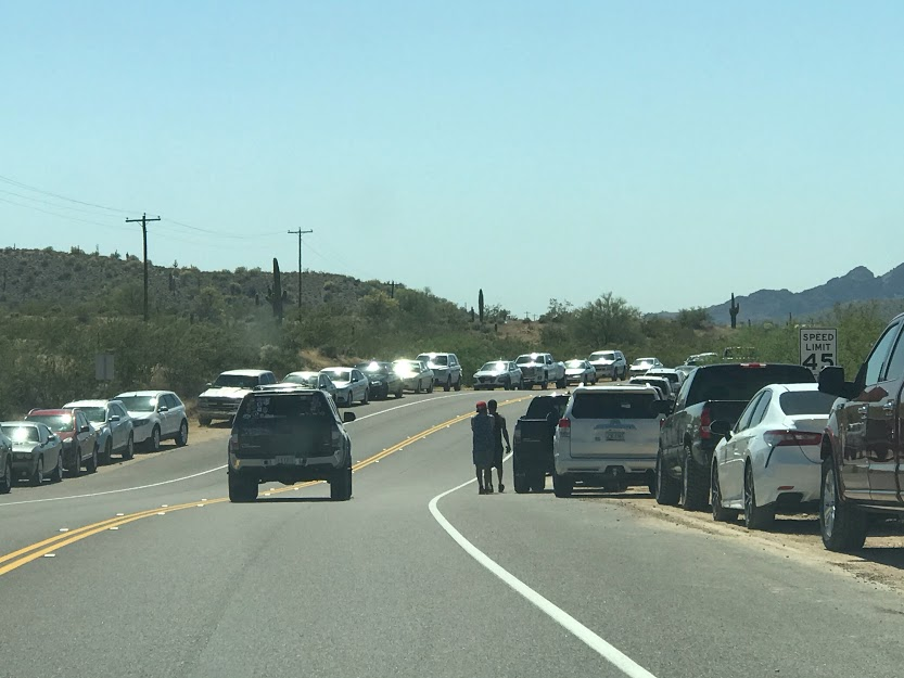 Cars are parked along each side of the road of Salt River.