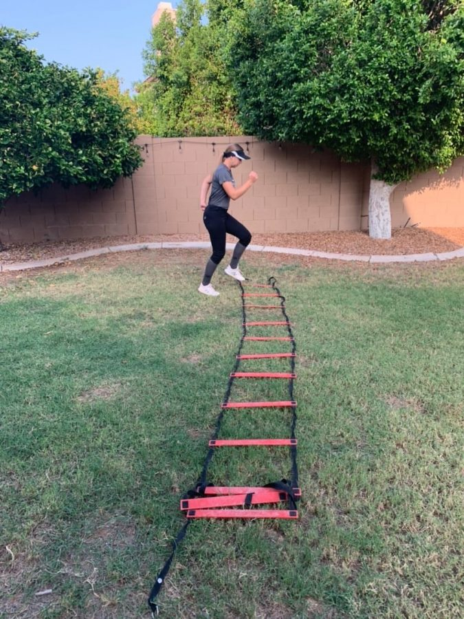 Junior Autumn Kunze practices for her upcoming softball season in her own backyard. Due to the  COVID-19 pandemic, players have had to resort to practicing independently and isolated from their teammates.