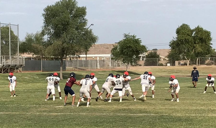 The JV football team practices on the Perry practice field on Thursday, September 17. Perry Football is preparing for the season even with setbacks due to COVID-19.
