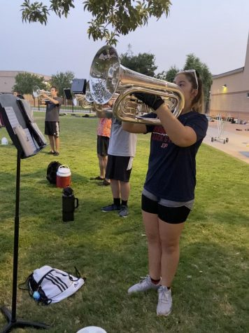 "Senior brass leader and baritone player, Kalea Watson, practices ""Jungle Boogie"" with the wind ensemble."