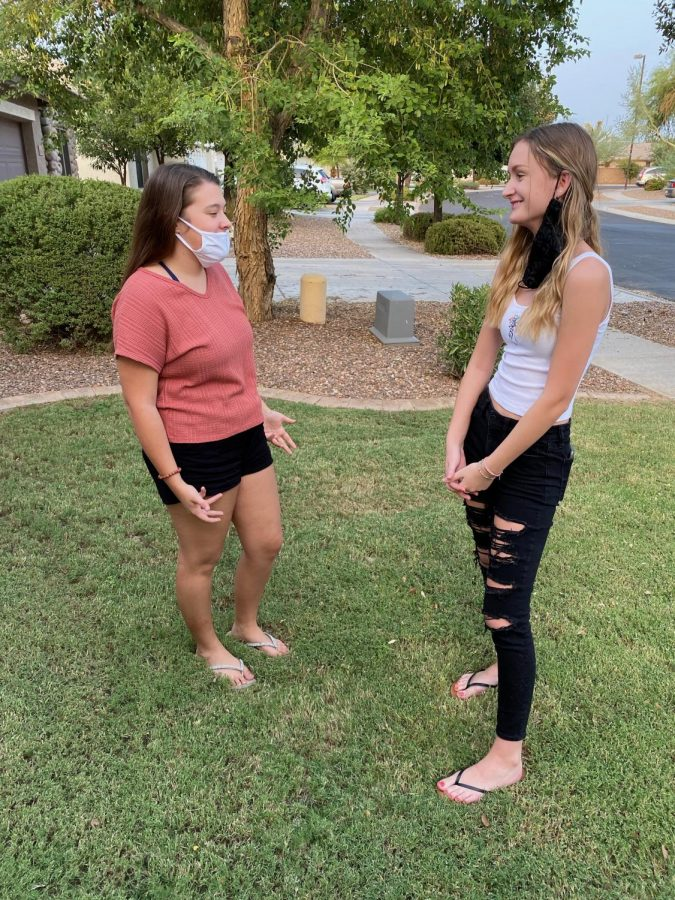 Juniors Lauren Ludwig and Mikaela Henriksen wear face masks incorrectly. During the COVID-19 pandemic, wearing face masks correctly became a priority.