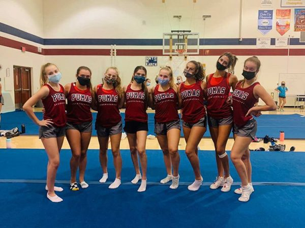 On their first week back to practice, cheer wears masks as a way to stay safe with COVID-19. The team makes sure to follow as many safety precautions as possible while still being able to practice.