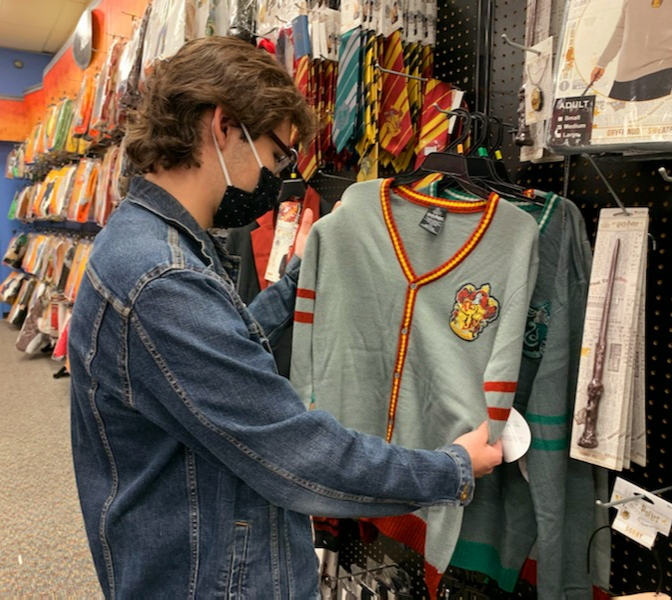 Highschool student, Ryan Cogley, looks for popular Halloween costumes, at a Spirit Halloween Store.