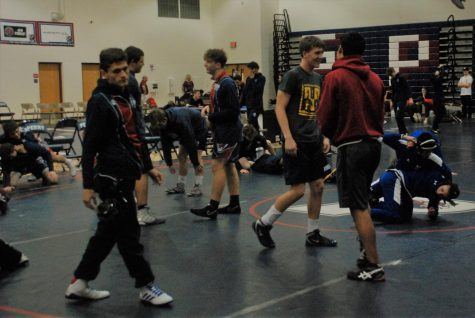 Perry wrestling gears up for a meet during the 2019-20 season. Perry wrestling broke several school records during the regular season, including winning sectionals and having several state placers.