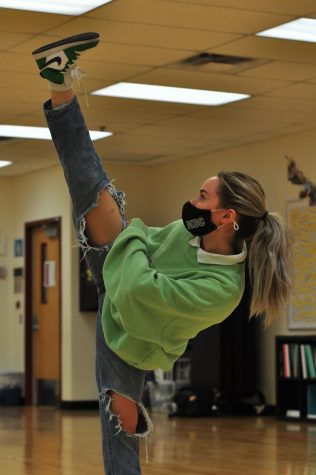 Junior Olivia Woodward-Shaw showcases her flexibility in the dance studio.