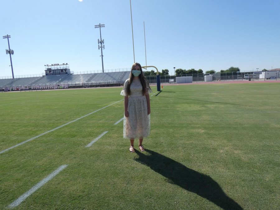Senior, Brooklyn Hawkins on the PHS football field in a mask. Homecoming dances this year look very different due to the health and safety concerns of COVID-19, which leaves students uncertain about high school activities.