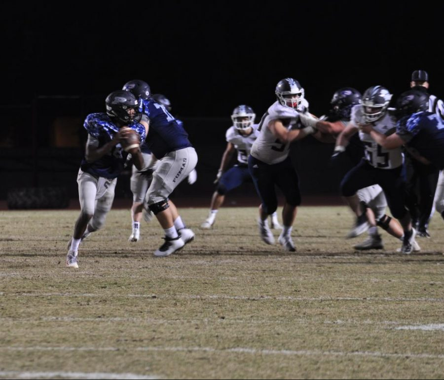 Senior quarterback, Ethan James playing against Pinnacle, on Friday November 13. The team had to take a two weeks off due to a quarantine, but came back ready to play.