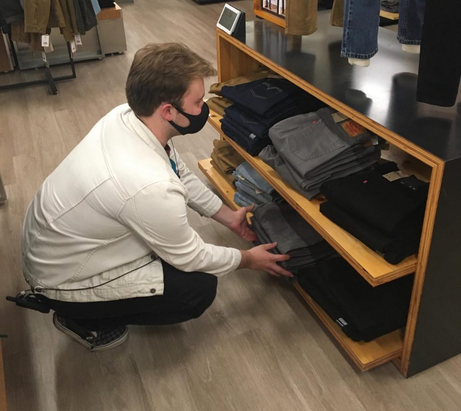 Eric ODell reorganizing jeans at Kohls