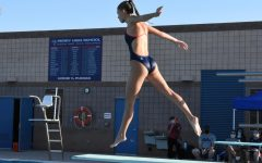 Kenzie Wagner jumps on the diving board  to start off her dive