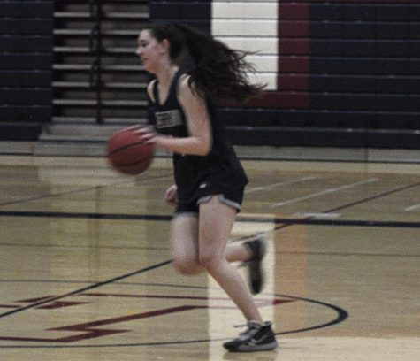 Senior power forward, Gabrielle Schwartz, practicing for the upcoming season.