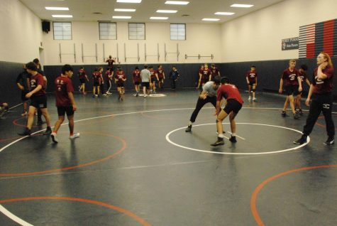 "Perry Wrestlers practice for a postponed season on Thursday Dec.10. COVID numbers have remained in the ""red  zone"", leaving winter sports athletes waiting for their first contest."