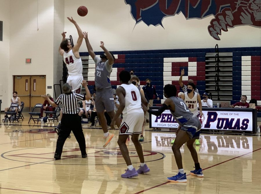 Dylan Anderson winning tip against Chandler during second game of the season. Perry beat their opponent 69-39.