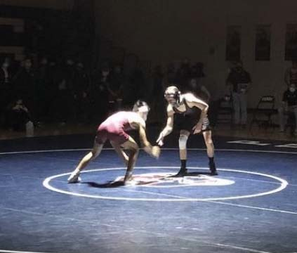 Senior Alex Gutierrez ties up against his opponent during the first wrestling match of the season.