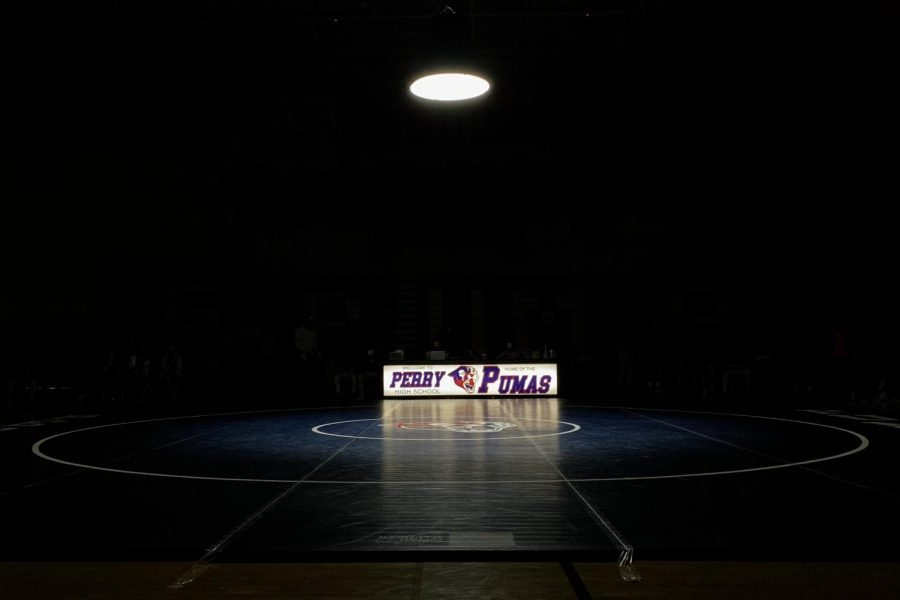 An empty gym sits in anticipation of the varsity wrestling team entering the gym.