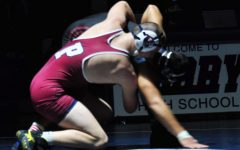 Freshman Wyatt Milnes wrestling against Red Mountain on January 19th.