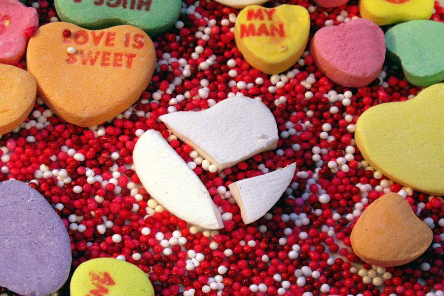 The broken heart candy represents the shattered Valentine's Day image this year.
