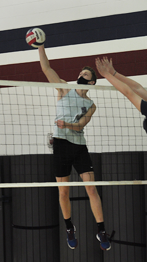 Senior middle blocker Cam Neiman at preseason practice on Friday Feb. 26 preparing for tryouts starting on Mar. 1st.