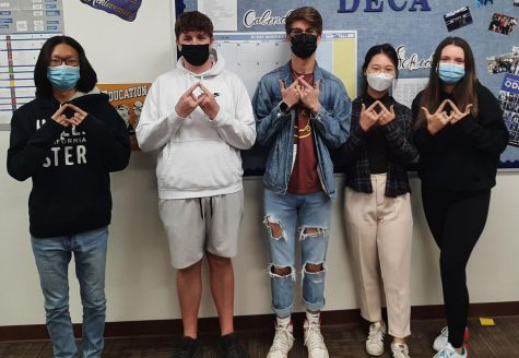 DECA officers Noah Kang, Cooper Lieurance, Sean Hadden, Yeijn Sohn (DECA President), and Emily Anasagasti (AZ DECA State Officer) celebrate receiving national certifications