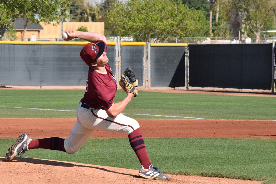 Senior Justin Still pitches during the varsity game against Brophy Prep. The team came out on top with a 5-2 victory.