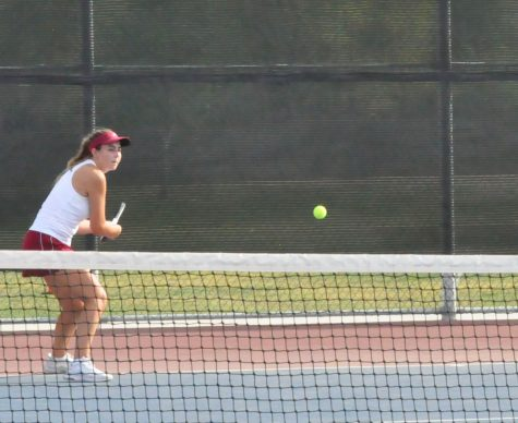Senior Jaiden Coylar competing in a singles-match against Highland High School on Thursday, Apr. 15. The team