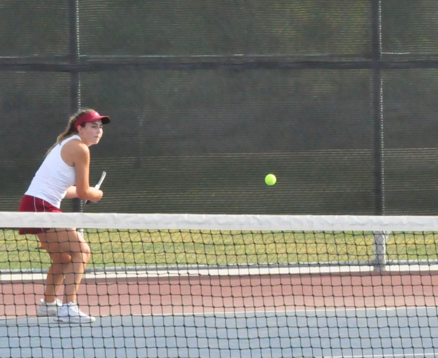Senior+Jaiden+Coylar+competing+in+a+singles-match+against+Highland+High+School+on+Thursday%2C+Apr.+15.+The+team%27s+rating+is+currently+10-3.