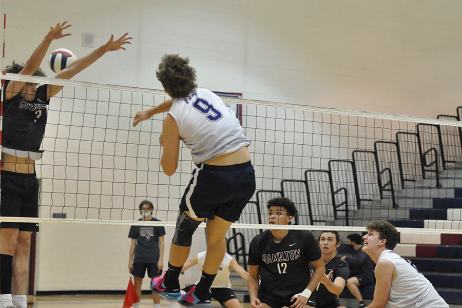 Senior Canyon Smith spikes the ball over the net during their game against Hamilton. The team later won 3-0, continuing their ongoing win-streak.