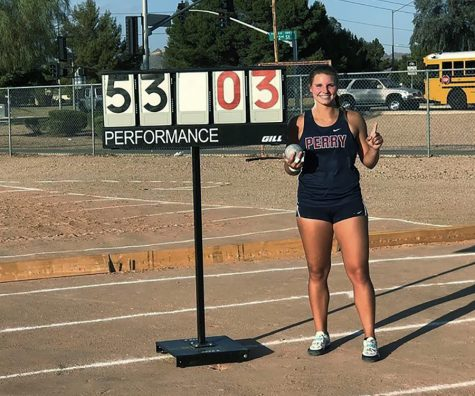 Senior Makayla Long poses with her score at the Red Mountain Rampage as the new national record holder for girls