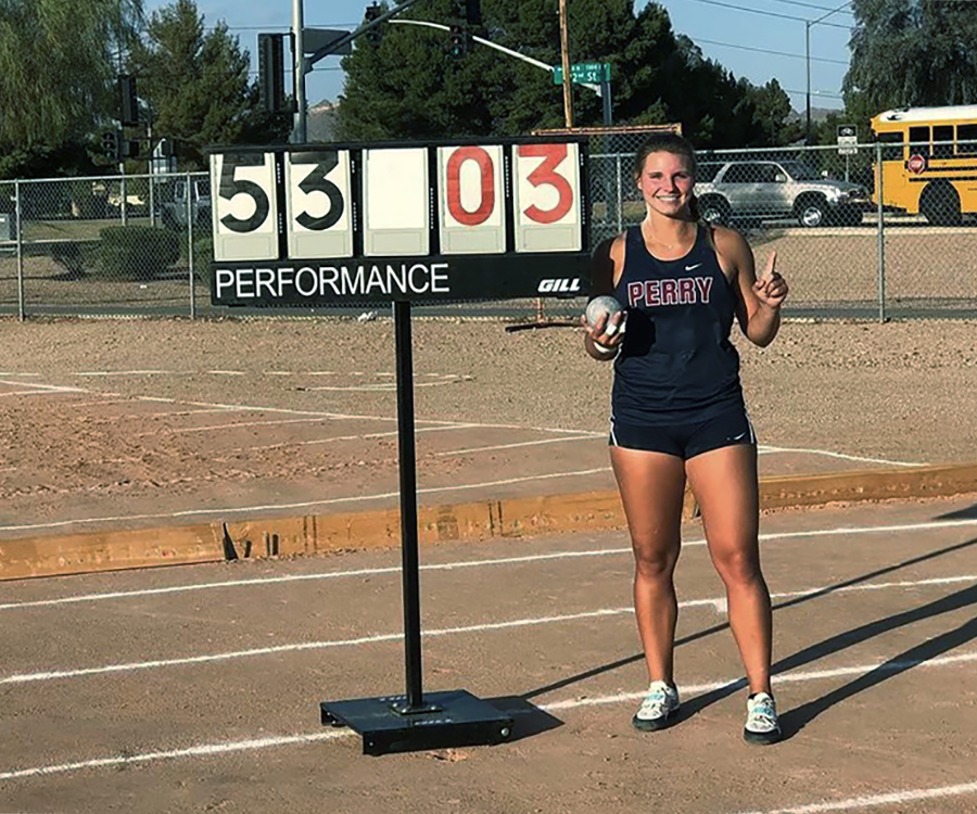 Senior Makayla Long poses with her score at the Red Mountain Rampage as the new national record holder for girls' shot put.