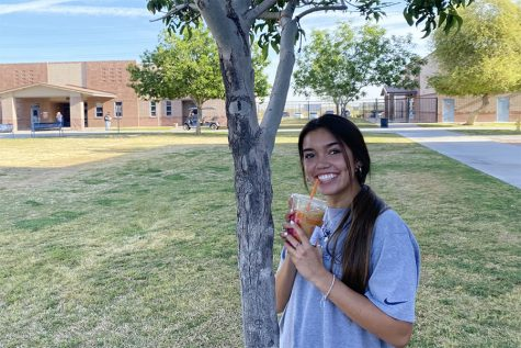 Senior Taylor Carrillo drinks the famous Dunkin