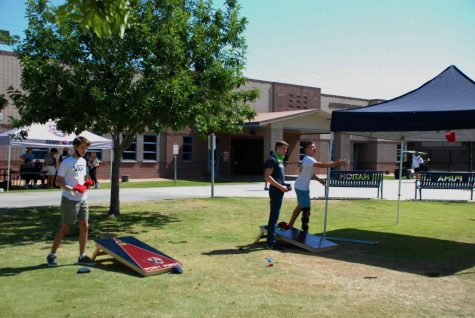 """During lunch, Luc Gourmelom (9), Matthew Johnson (9), and Koen Martineau (9), play Cornhole during """"Fun Friday"""". The counseling department organized the event with the intention to get kids moving."""