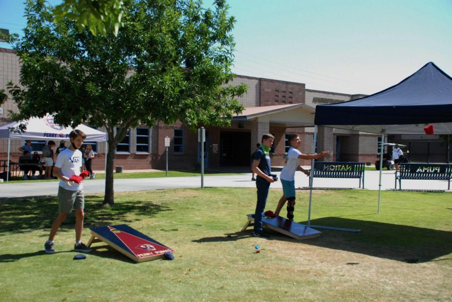 During lunch, Luc Gourmelom (9), Matthew Johnson (9), and Koen Martineau (9), play Cornhole during