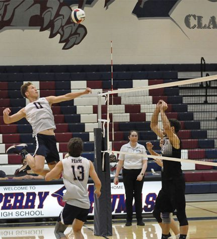 Senior Camden Neimann spikes the ball on their opposing team, Red Mountain. The team later won the match 3-0.