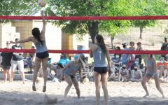 Beach volleyball Captain, Jordan Suan serves at recent game. Suan has proved to be a leader to the girls and hopes that their continued success will qualify them for a state title next year.