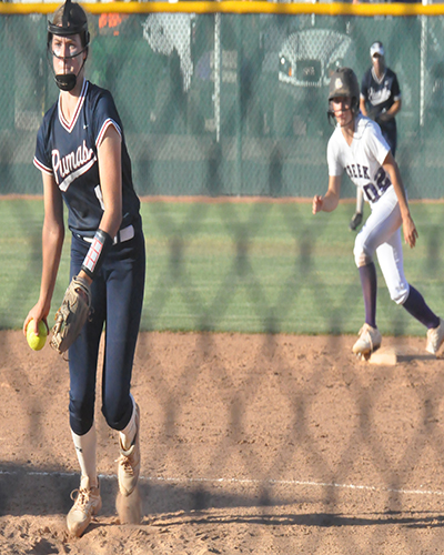 Freshman Sarah Phillips pitching in the game against Queen Creek on May 5th. The team won the game pushing them into the playoffs.
