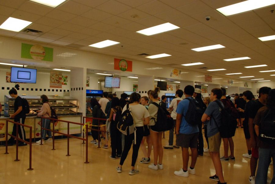 Students wait during C lunch for their food. Lunches lines have been longer this year, from more populated lunch.