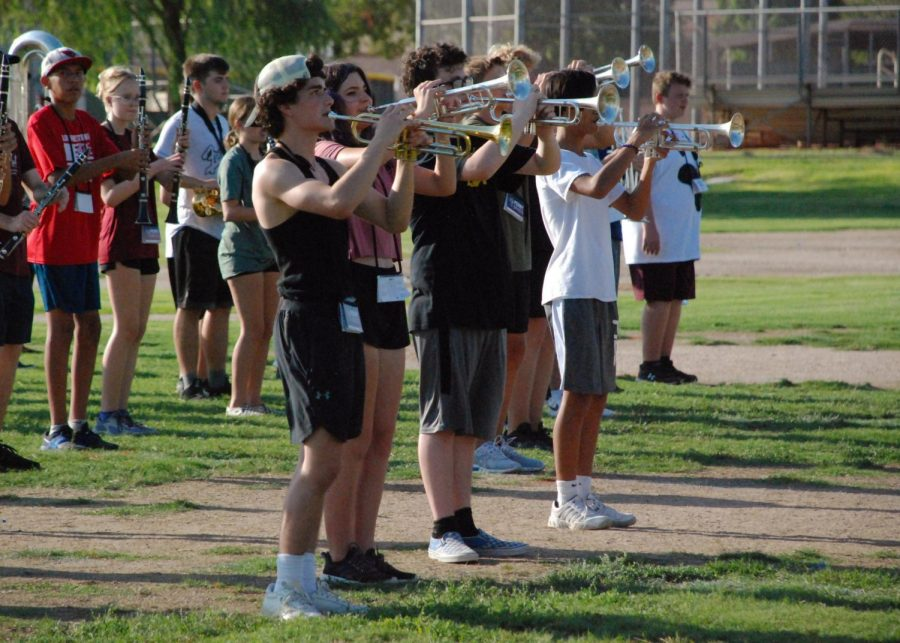 Jacob+Nieves+%2812%29+and+Maddie+Woods+%2811%29+practice+with+the+trumpet+section+in+preparation+for+their+field+show.+The+Puma+Regiment+performs+a+eight+minute+show%2C+where+students+have+to+play+their+instruments+and+walk+simultaneously.