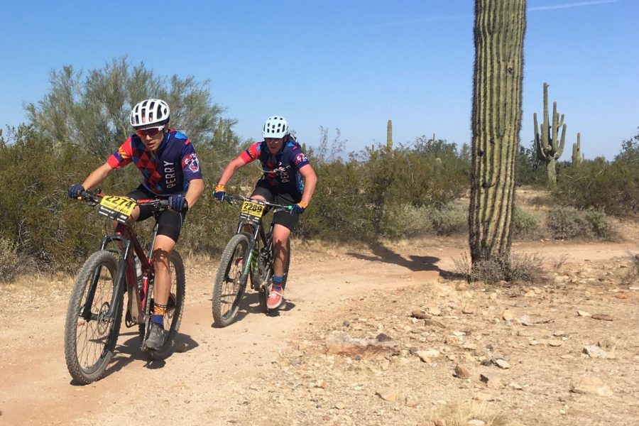 Senior Brayden Baker and fellow teammate race at competition. The Mountain Biking Team competed in five races during their season.