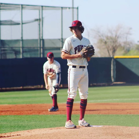 Senior baseball player Stephen Hernandez prepares to pitch during a home game. Hernandez finished last season with a 5.25 Earned Run Average (ERA), which is the number of runs the pitcher allows every nine innings.