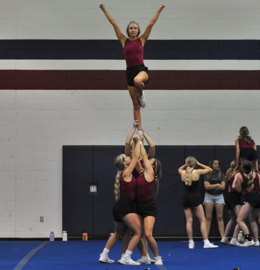 Senior cheerleader Skylen Kerbs works on hitting stunts without any balance checks during the first hour cheer-locker. Skylen has been a part of Perry cheer for four years, with three of those years on varsity.