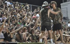 Seniors Cort Cooley and Preston Felker dance on top of the push-up board during a football game. The home game against Basha was camouflage themed.